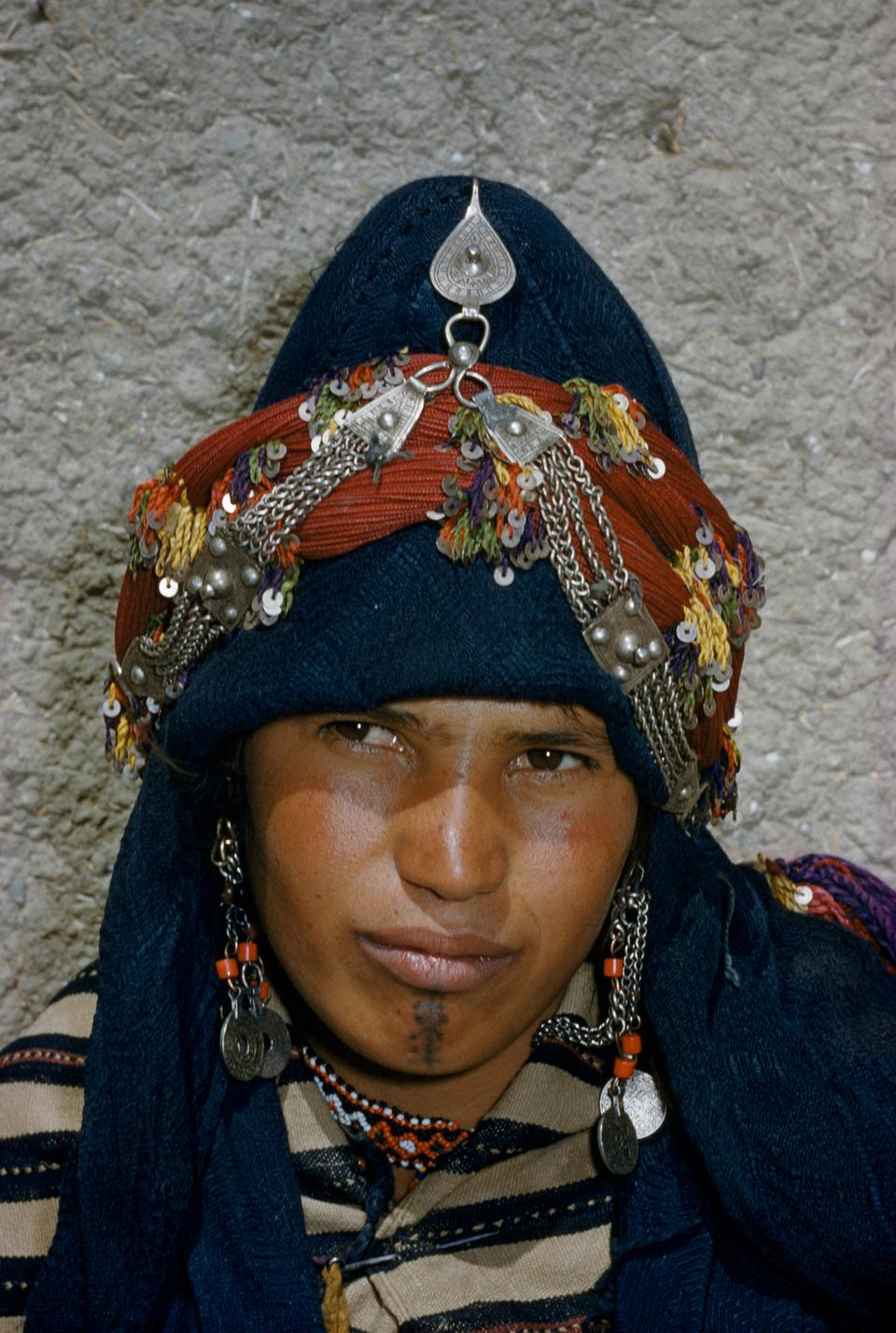 In this file photo, a Berber woman of Ait Haddidu tribe wears her wealth in silver jewelry, French Morocco.