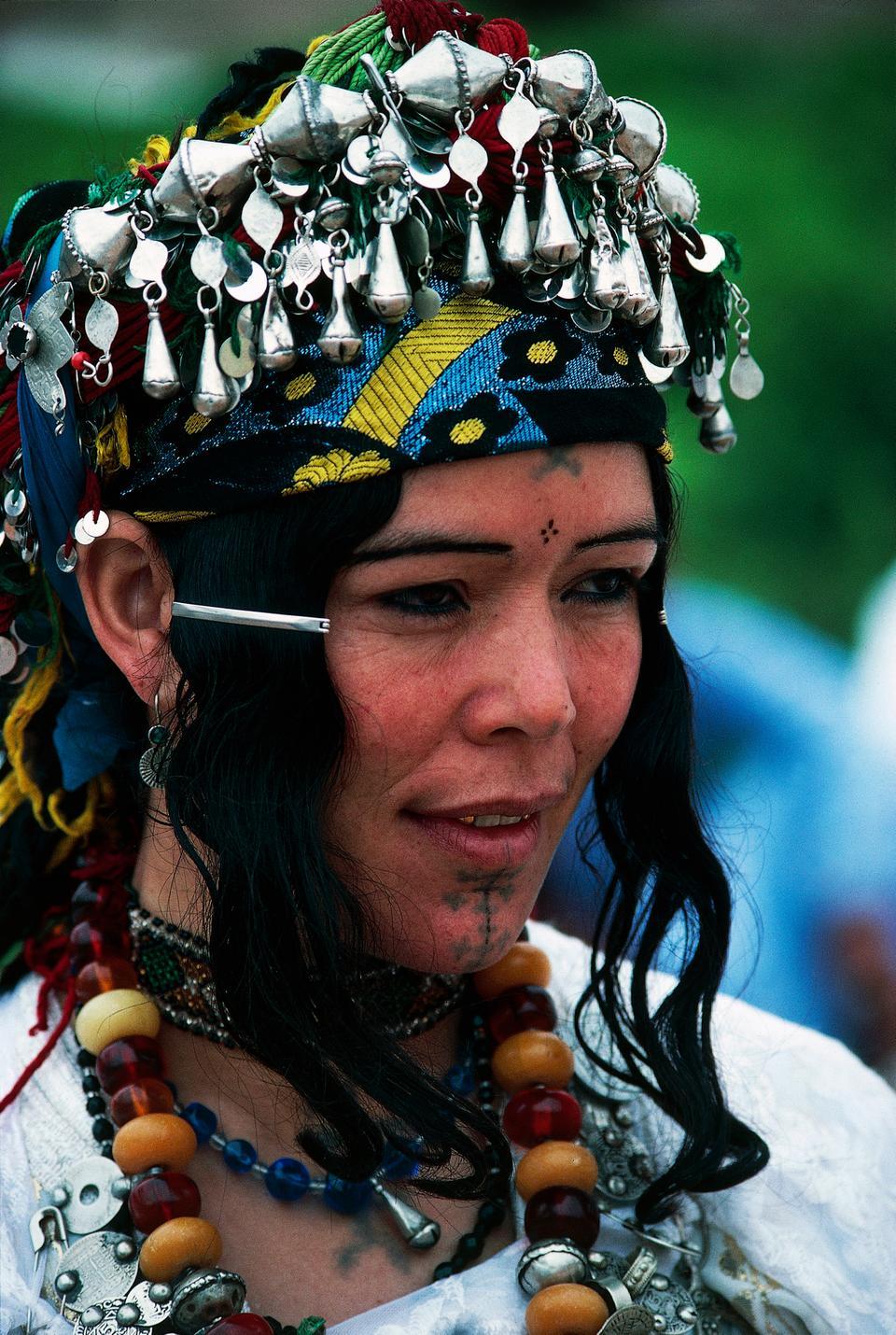 Berber woman wearing traditional costume and ethnic jewelery, Ait Bougmez, Morocco.