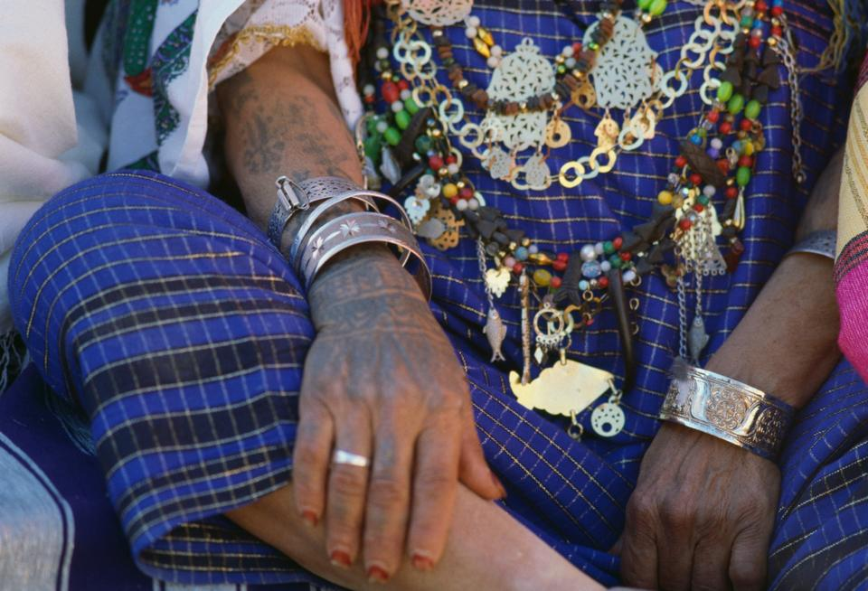 Woman with bracelets and necklaces, Matmata Berber festival, Tunisia.