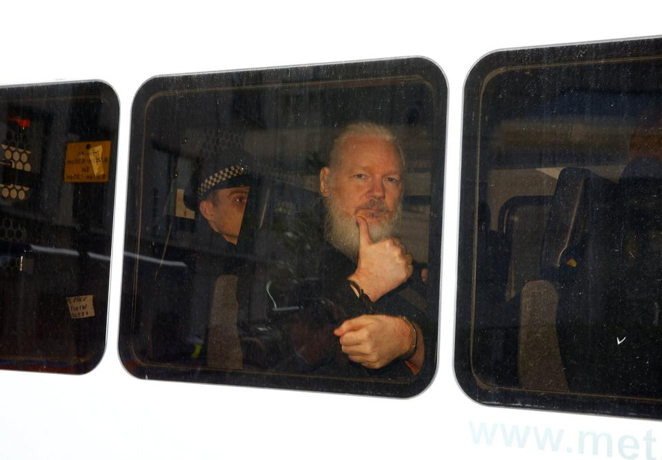 WikiLeaks founder Julian Assange is seen in a police van after was arrested by British police outside the Ecuadorian embassy in London, Britain April 11, 2019.
