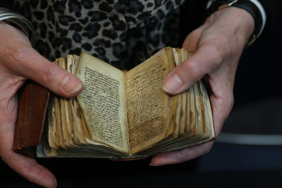 A tiny version of Islamic Holy Book of Quran estimated to be written in the 10th century.