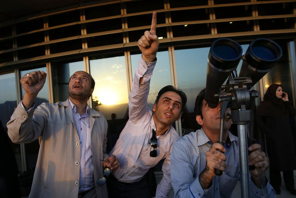 Iranian Muslims in Tehran search for the new moon, which marks the start of Ramadan [File image: Vahid Salemi/AP Photo]
