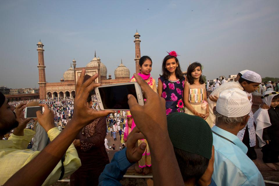 Indian Muslims mark the Eid holiday [Manish Swarup/AP Photo]
