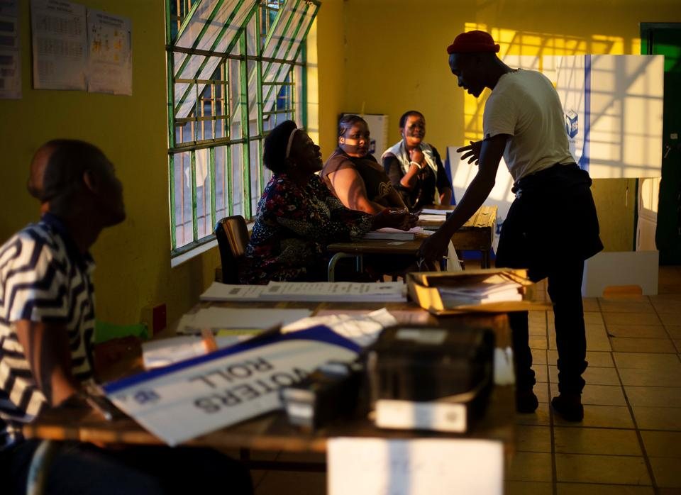 Election officials rehearse processing a voter at a voting station in Embo near Durban, South Africa. (May 7, 2019)