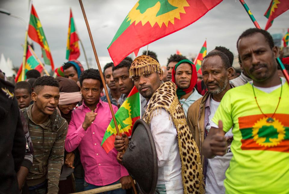 Ethiopians wearing traditional Oromo costume gather to welcome returning leaders of the once-banned Oromo Liberation Front (OLF) in the capital Addis Ababa, Ethiopia Saturday, Sept. 15, 2018.