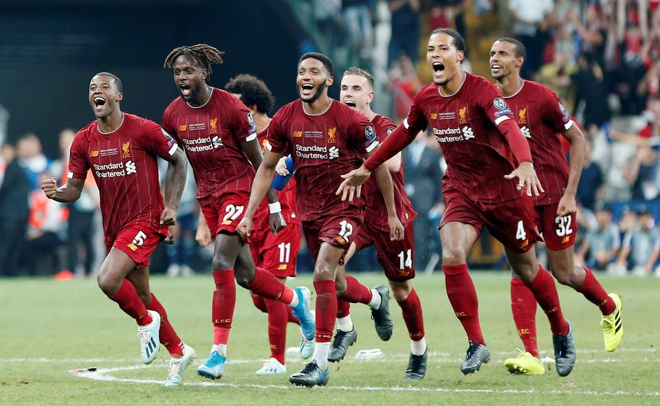Liverpool's Virgil van Dijk, Joe Gomez, Georginio Wijnaldum and teammates celebrate winning the UEFA Super Cup after a penalty shootout, Vodafone Arena, Istanbul, Turkey. August 14, 2019