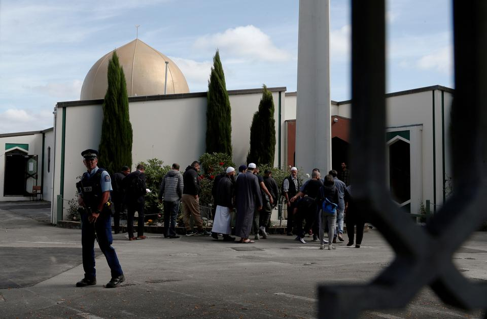 A policeman stands guard as members of the Muslim community visit Al-Noor mosque after it was reopened in Christchurch, New Zealand, March 23, 2019.