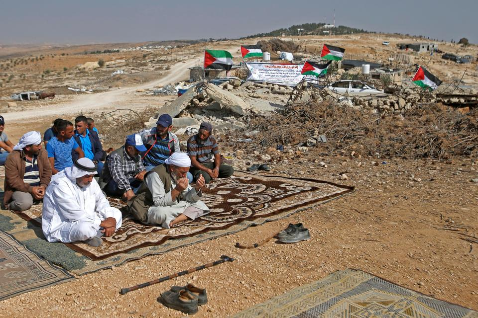 Palestinians attend Friday prayer during a protest against Jewish settlements near Yata, in the Israeli-occupied West Bank November 1, 2019.