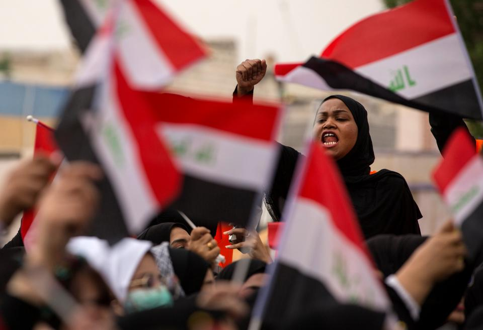 An Iraqi demonstrator chants as she takes part in an anti-government march in the center of the southern city of Basra on December 2, 2019. Iraq's rival parties were negotiating the contours of a new government today, after the previous cabinet was brought down by a two-month protest movement demanding more deep-rooted change.