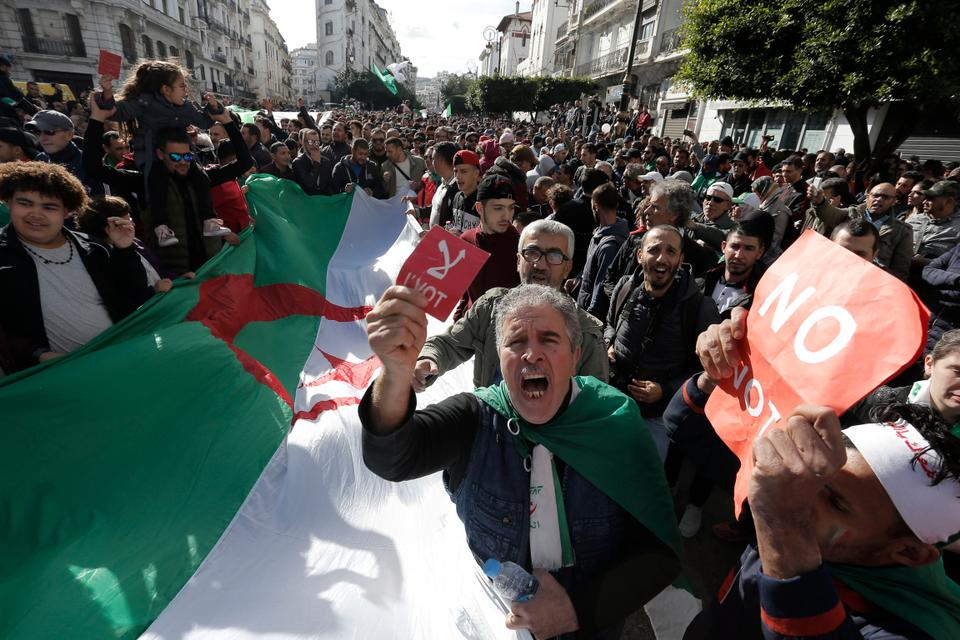 Algerian demonstrators take to the streets in the capital Algiers to reject the presidential elections, in Algeria, December 12, 2019.