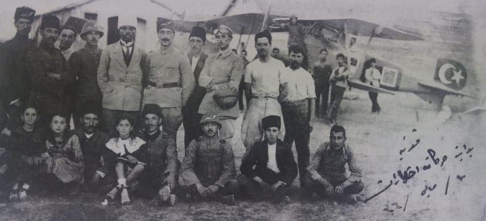 Ahmet Ali Celikten wearing a white headgear next to his fellow fighter pilots at Konya Aircraft Station on 7 May 1920, the year when the Turkish War of Independence was at its peak.