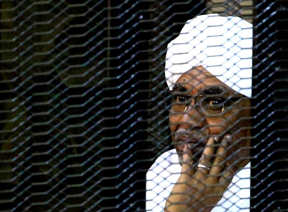 Sudanese former president Omar Hassan al-Bashir sits inside a cage as he faces corruption charges in a court in Khartoum, Sudan September 28, 2019.