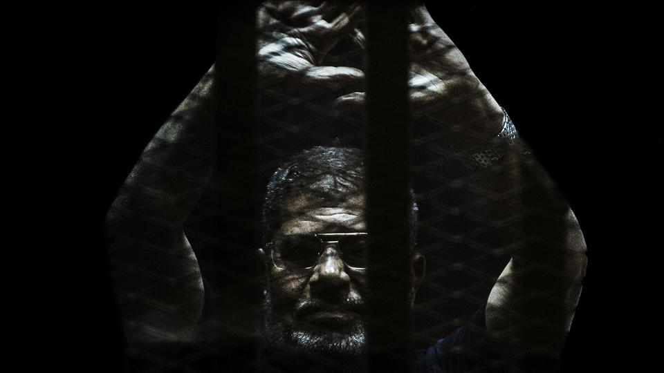 Former President Mohammed Morsi is pictured behind Egyptian bars before his suspicious death in a courtroom hearing on June 17, 2019.