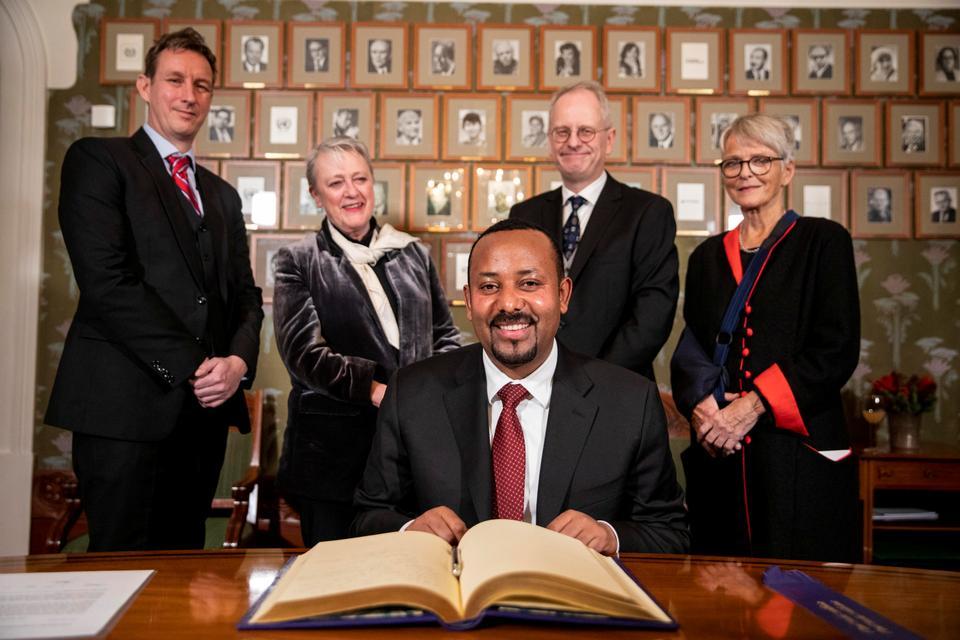 2019 Nobel Peace Prize laureate, Ethiopia's Prime Minister Abiy Ahmed poses with Nobel committee members (L-R) Asle Toje, Berit Reiss-Andersen, Henrik Syse and Anne Enger, in Oslo, Norway, December 9, 2019.