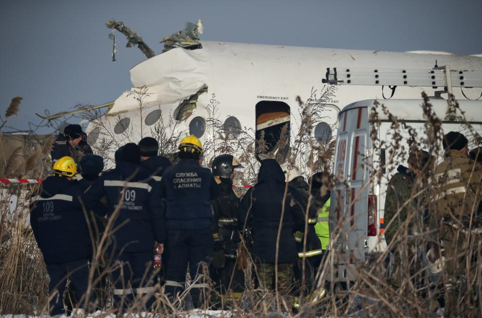 Emergency and security personnel are seen at the site of the plane crash near Almaty, Kazakhstan, December 27, 2019.