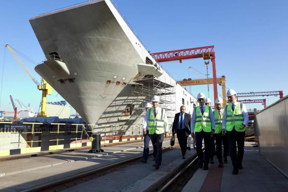 Turkish officials visit to see the construction of TCG Anadolu, Turkey's first aircraft carrier built by a native company, in Istanbul's Tuzla port in November 2019.
