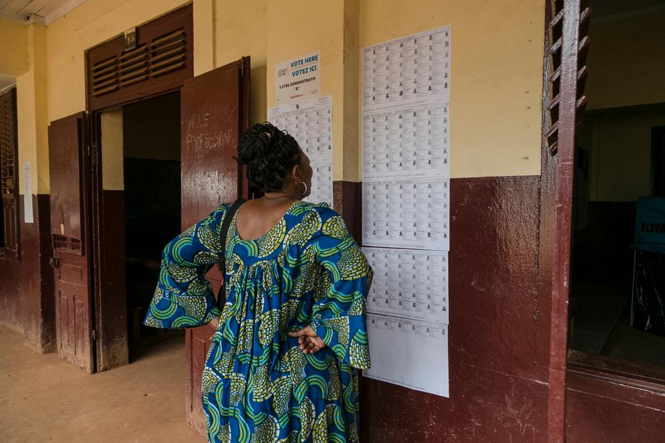 A lady is looking for her name on the voters' list before she votes in the general and municipal elections in Yaounde on February 9, 2020.