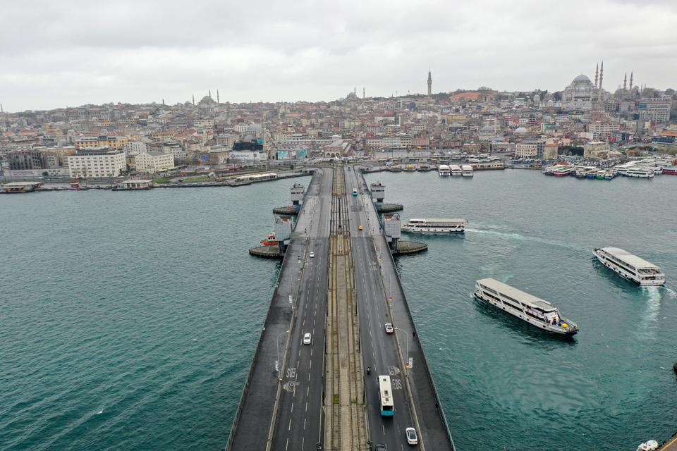 A drone photo shows an aerial view of empty Galata Bridge and its surroundings, after authorities urging people to stay home as part of coronavirus (COVID-19) precautions on March 24, 2020 in Istanbul, Turkey.