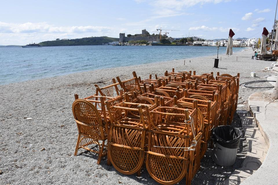 The picture shows gathered seats of a cafeteria at the beach next to historic Bodrum Castle on 23 March, 2020, Bodrum district of Mugla, Turkey.