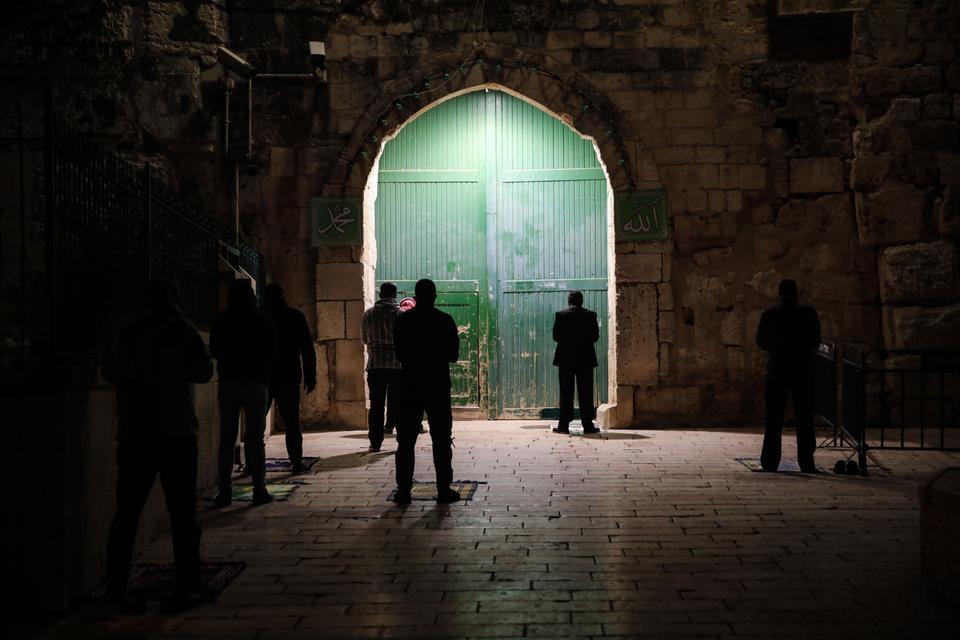 Palestinian worshippers perform the Taraweeh prayer in Jerusalem.