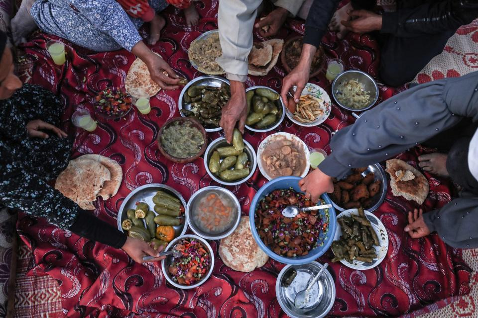 Palestinian family break their fast during iftar dinner of Ramadan in Gaza City, Gaza on April 26, 2020.