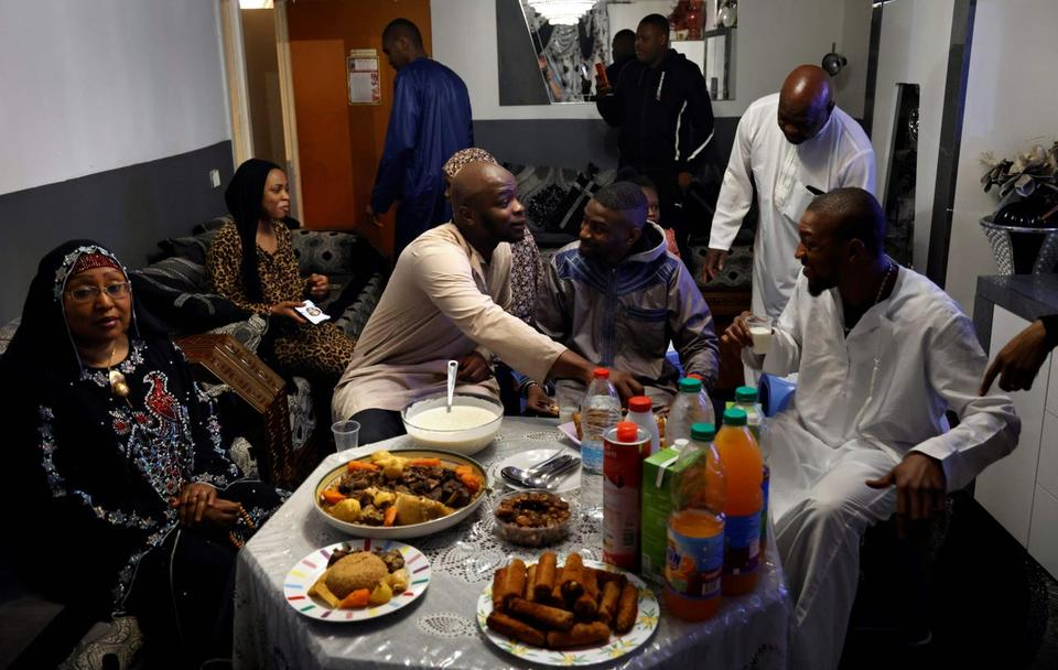 A French muslim family have the traditional Iftar meal, the meal after sunset during the Islamic holy month of Ramadan, in Paris, on April 24, 2020, as the country is under lockdown to stop the spread of the Covid-19 pandemic caused by the novel coronavirus.