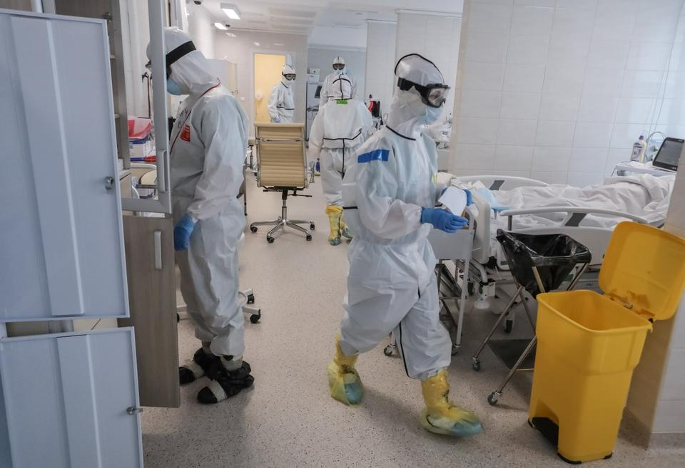 Medical specialists wearing personal protective equipment (PPE) work in the Intensive Care Unit (ICU) for coronavirus disease (COVID-19) patients at a hospital in Moscow, Russia, in this handout picture released on May 3, 2020.