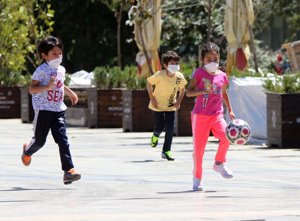 Children enjoy outdoor time at Ataturk Kent Square in Aydin, Turkey on May 13, 2020.