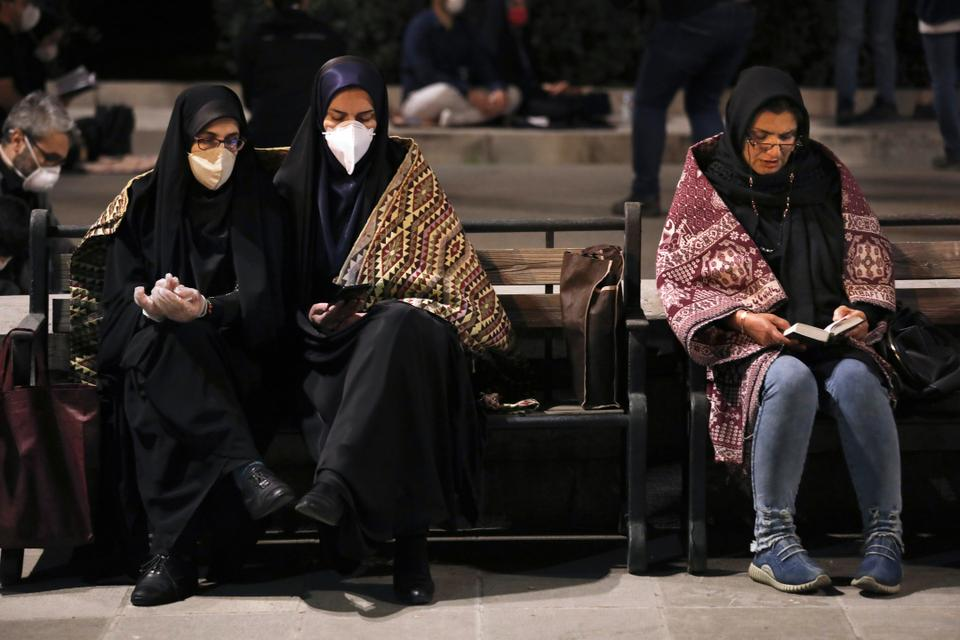 Worshippers, some of them wearing protective face masks to help prevent the spread of the coronavirus, pray outside the mosque of the Tehran University in Laylat al-Qadr, or the night of destiny, during holy fasting month of Ramadan, Iran, Tuesday, May 12, 2020. On Tuesday authorities allowed mosques temporarily reopen for limited hours up, while strictly observing health and social procedures to prevent spreading the disease. (AP Photo/Vahid Salemi)