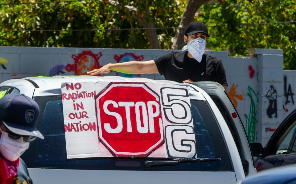 Anti-5G activists stage a demonstration on the steps of The Casa del Mexicano, an 82-year-old cultural center, in opposition to the ongoing construction of 4G/5G cell towers in the Boyle Heights neighborhood of Los Angeles, Saturday, May 2, 2020.