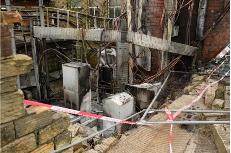 Damaged cabling and telecommunications equipment is pictured following a fire at a phone mast in Huddersfield on April 17, 2020