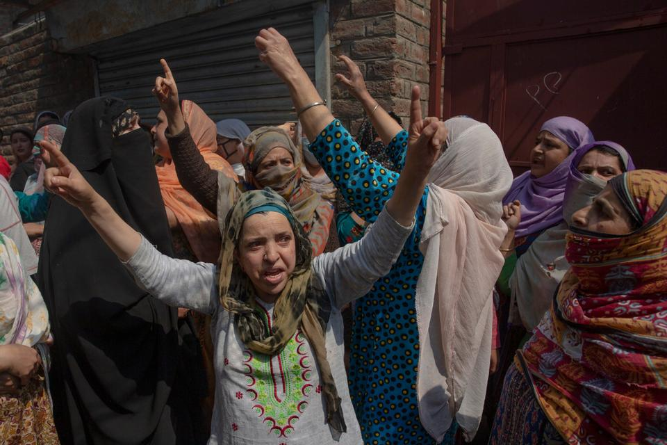 Kashmiri women, including fire victims, chant anti-India slogans and accuse Indian armed forces of deliberately setting their properties on fire.