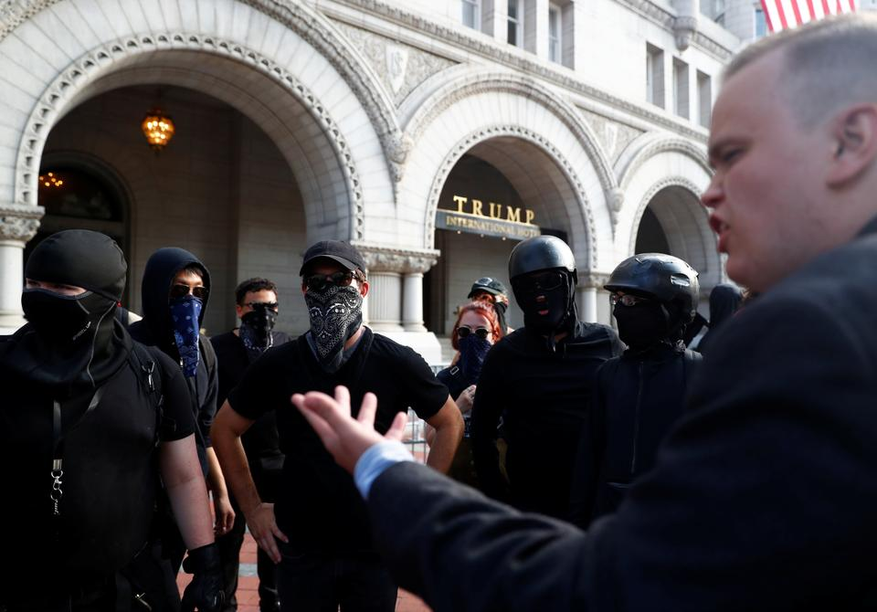 Antifa counter-protesters gather outside the Trump International Hotel as they demonstrate against the
