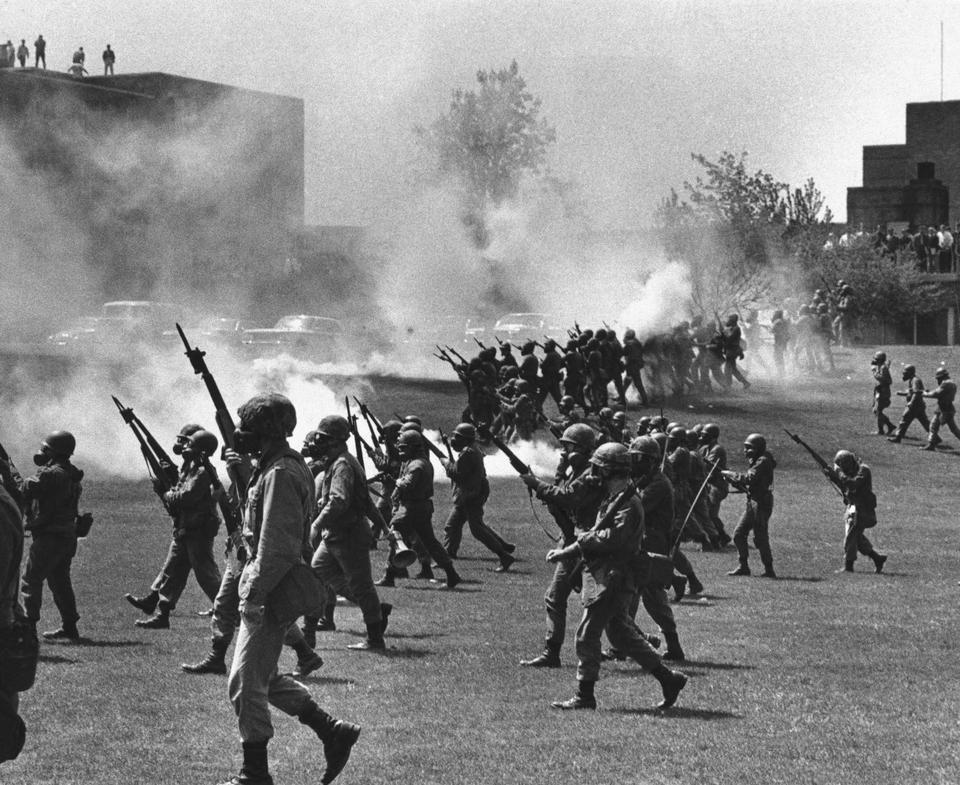 In a May 4, 1970 file photo, Ohio National Guard moves in on rioting students at Kent State University in Kent, Ohio. Four persons were killed and eleven wounded when National Guardsmen opened fire.