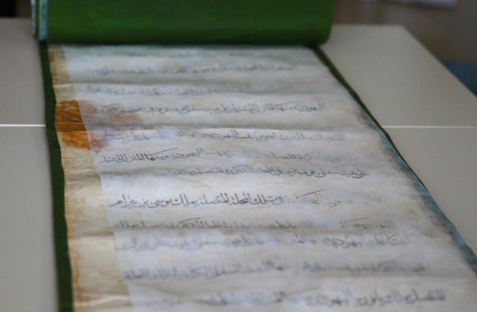 Caption: The Sultan's charter is carefully preserved, and treated multiple times a year to ensure its longevity.