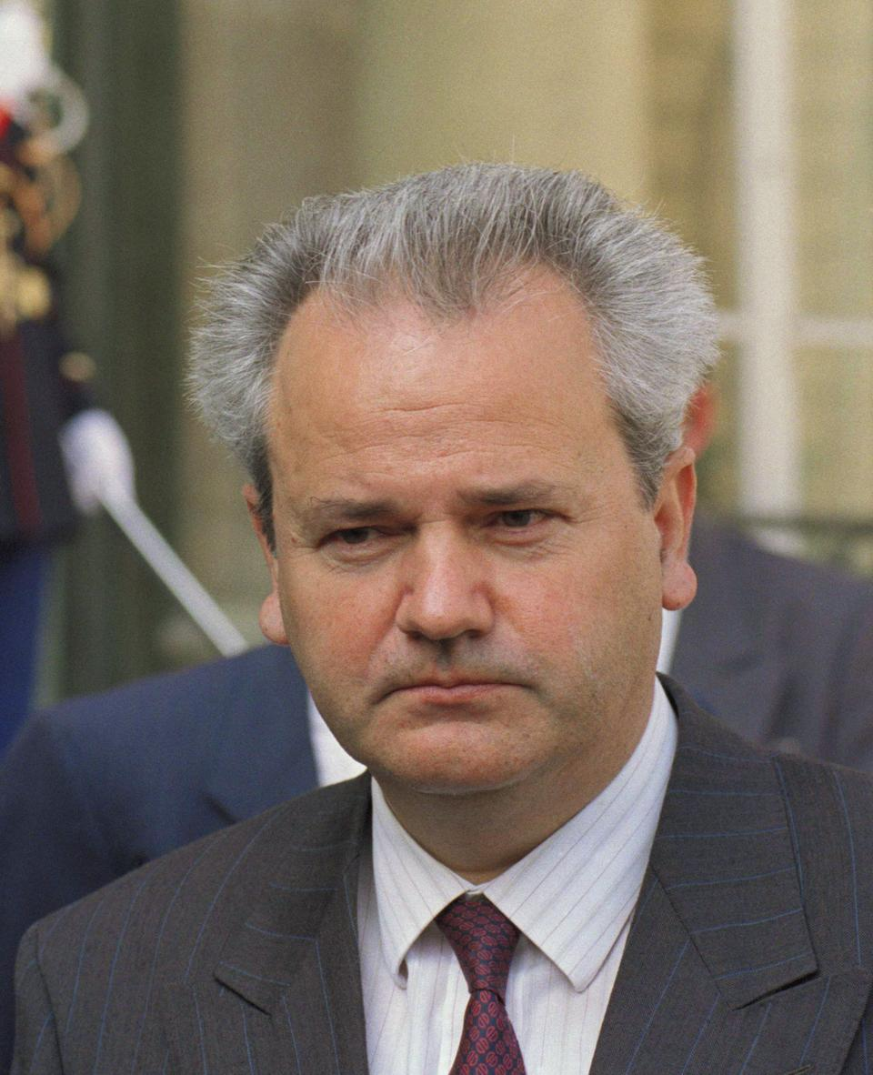 Serbian President Slobodan Milosevic walks past a Republican guard as he leaves the Elysee palace in Paris, Aug. 29, 1991, after a 90-minute meeting with French President Francois Mitterrand.