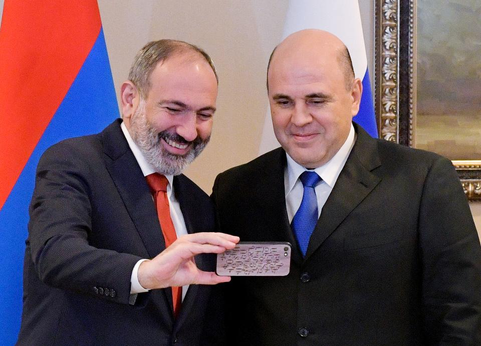 Russian Prime Minister Mikhail Mishustin and his Armenian counterpart Nikol Pashinyan take a selfie during a meeting in Almaty, Kazakhstan January 31, 2020.