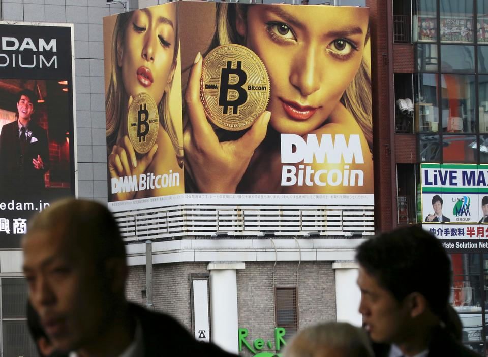 An advertisement of Bitcon is displayed near a train station in Tokyo Monday, Jan. 29, 2018.