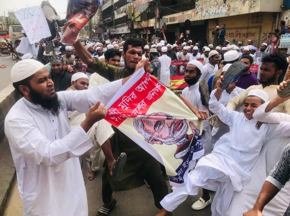 Bangladeshis pull a banner displaying sketch of Indian Prime Minister Narendra Modi during a protest against the communal violence in New Delhi last month, after Friday prayers in Dhaka, Bangladesh, Friday, March 6, 2020.