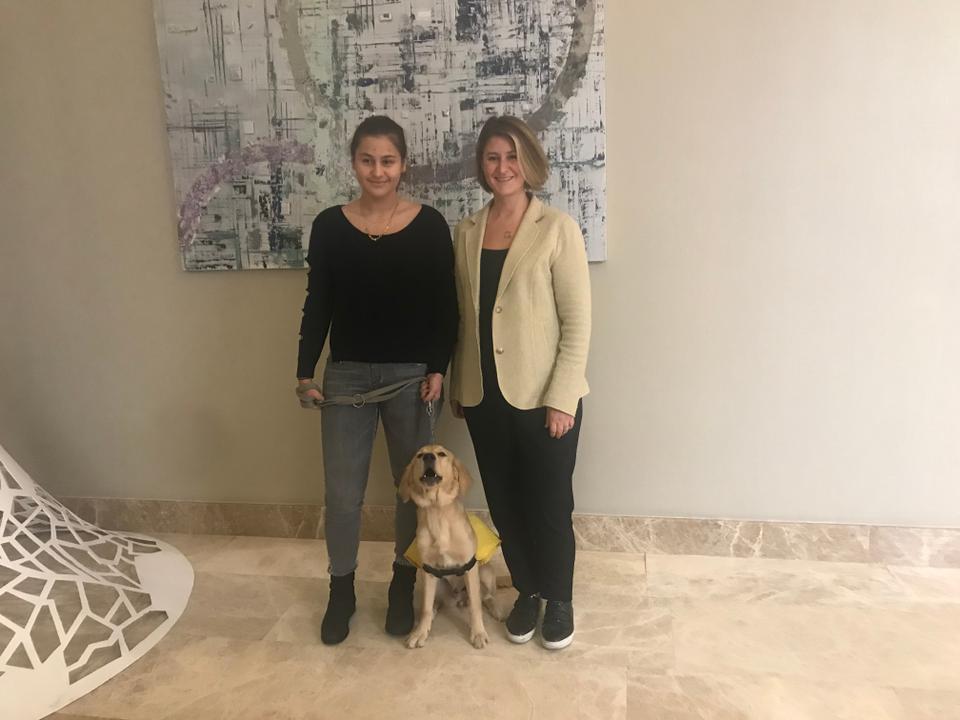 Ece Beydagi (R) with her daughter Deniz and their foster dog, Nacho.