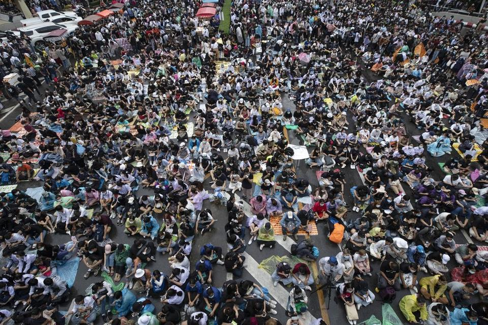 Hundreds of pro-democracy protesters gather in a business district in Bangkok, Thailand, Friday, Oct. 16, 2020. Thailand's prime minister has rejected calls for his resignation as his government steps up efforts to stop student-led protesters from rallying in the capital for a second day in defiance of a strict state of emergency.