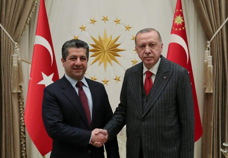 Turkey's President Recep Tayyip Erdogan, right, shakes hands with Masrour Barzani, left, Prime Minister of Iraqi Kurdish Regional Government, prior to their meeting at the Presidential Palace, Nov. 28, 2019.