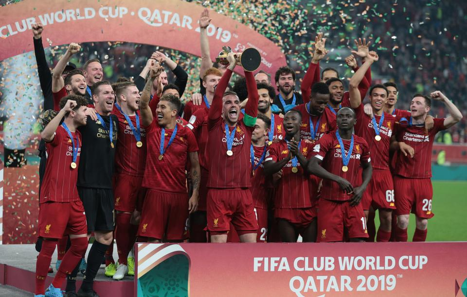 Players of Liverpool lift the trophy during a ceremony at the end of the FIFA Club World Cup Qatar 2019 Final match between Liverpool FC and CR Flamengo at Khalifa International Stadium in Doha, Qatar on December 21, 2019.