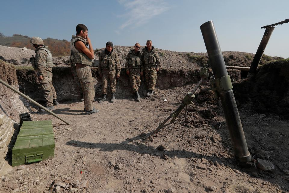 Armenian soldiers gather at their fighting positions on the front line during a military conflict against Azerbaijan's armed forces in occupied Karabakh, October 20, 2020.