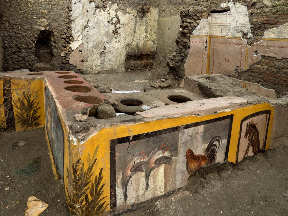 Frescoes on an ancient counter found during excavations in Pompeii, Italy, can be seen in this photo published on December 26, 2020.