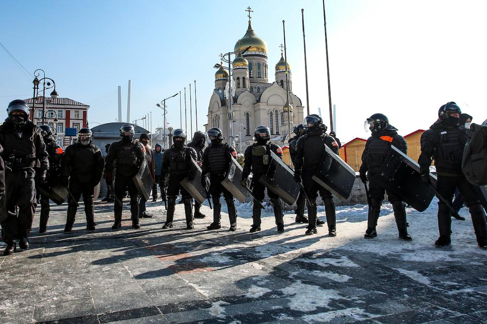 Police officers stand blocking enter to the central square in Vladivostok, Russia, on Sunday, January 31, 2021