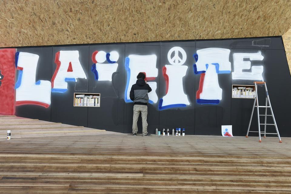 A street artist writes