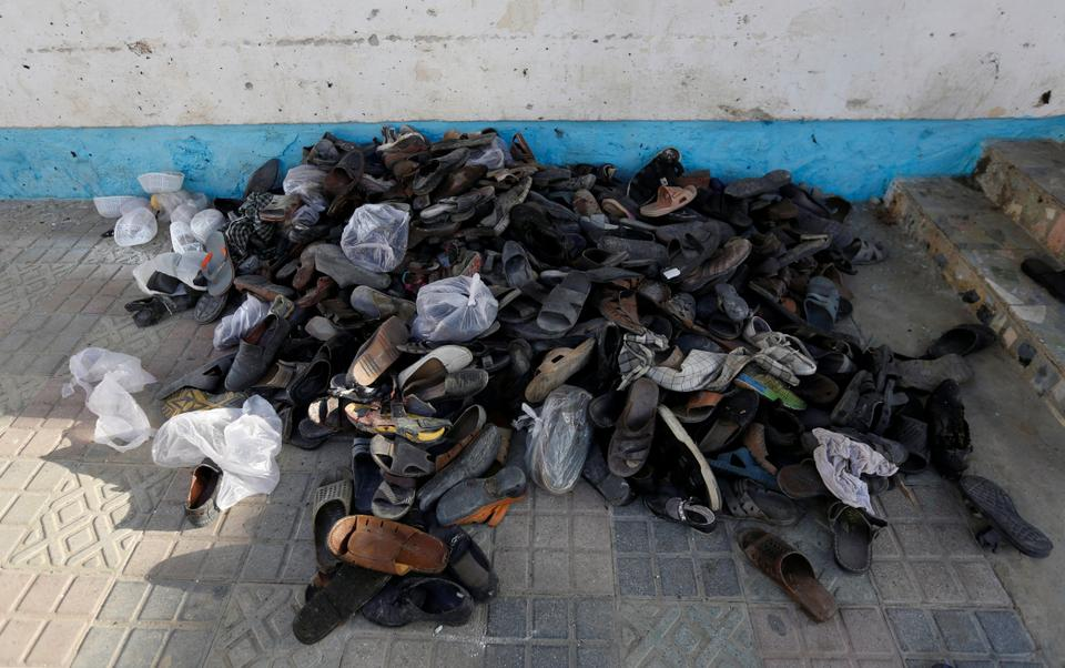 The shoes of victims are seen at a mosque after a Daesh attack in Kabul, Afghanistan.