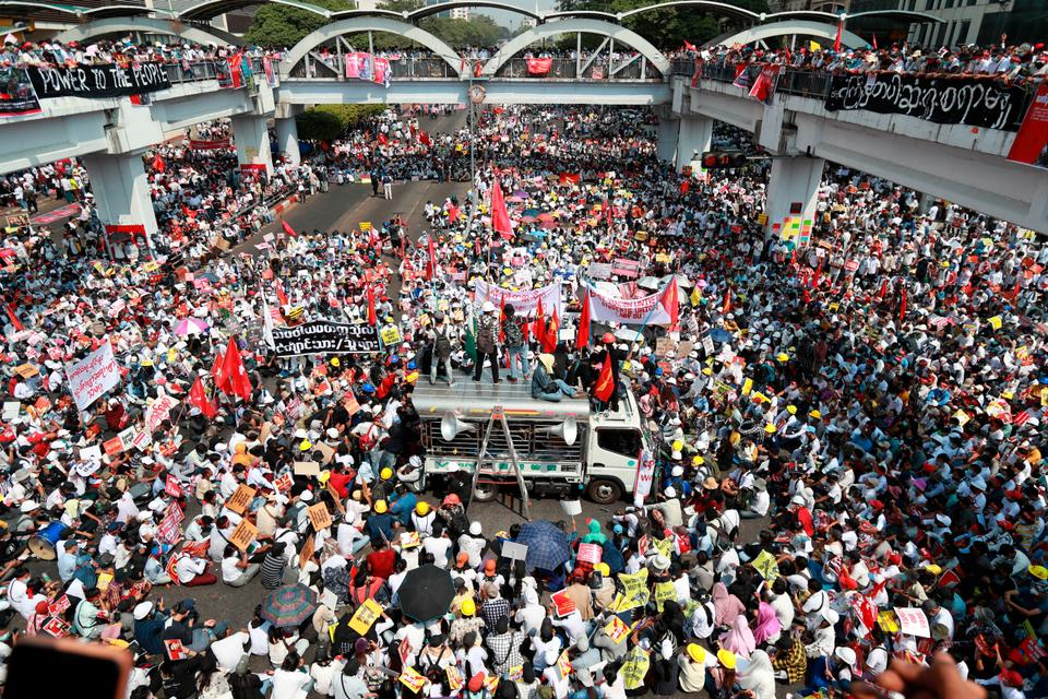 Anti-coup protesters gather at an intersection in downtown Yangon, Myanmar, on February 22, 2021.